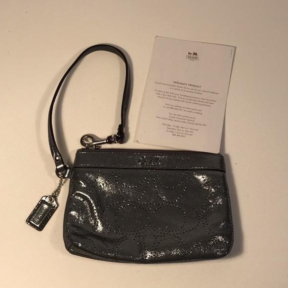Coach Handbags - Coach Perforated Logo Silver Wristlet